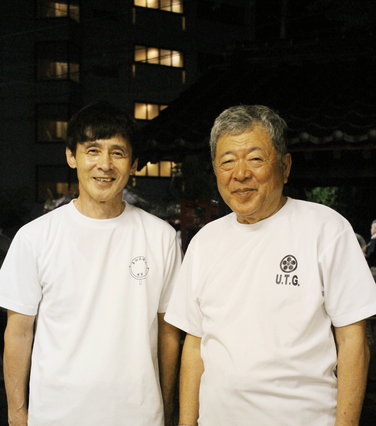 籠町自治会長の工藤是正さん(右)と、「龍踊」総指揮の山口厚志さん。