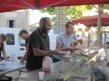 Jean Paul et Ludovic sur le marché