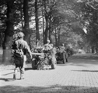 Soldiers of the 2nd Battalion South Staffordshire Regiment marching on a road between Oosterbeek and Arnhem. 19 September 1944.