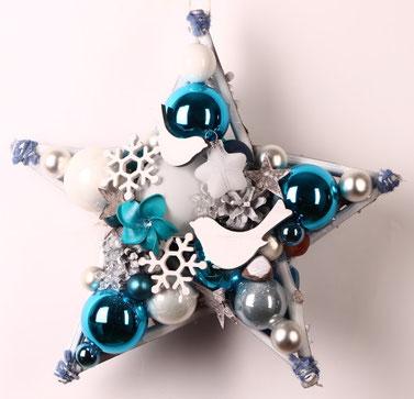 Blau-weißer Stern mit Holzvögeln