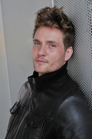 Stefan Mogel Portrait, Head Shot, sexy, leather jacket.