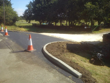 "And the site now has a proper ""Highways Standard"" entrance - with tarmac & curbs"