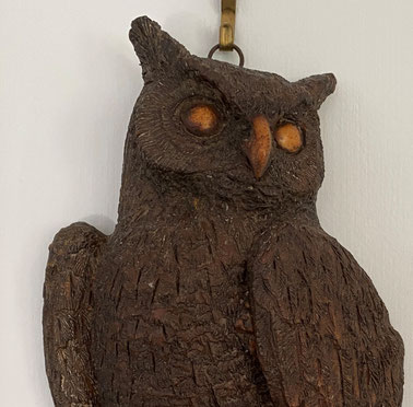 A finely carved wall hanging owl