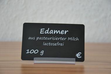 Preisschild schwarz matt, bedruckt mit weißer Transferfolie, Liegehalter transparent ohne Erhöhung