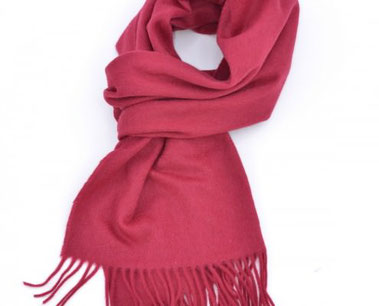 A typical pink muffler scarf worn .