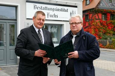 Andreas Räffler (links) und sein Chef André Fuchs (rechts) arbeiten nun in den neuen Büroräumen auf der Hammerschmiedtstraße. © Rafael Sampedro/foto-sampedro.de