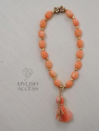 珊瑚のコーラルピンクタッセルブレスレット#388