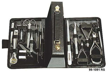Picture shows the opened black Leather Case filled with  stainless-steel  Scissors, Manicure und Pedicure Instruments