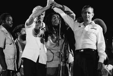 Bob Marley joins the hands of political rivals, Michael Manley and Edward Seaga at the One Love Peace Concert 1978