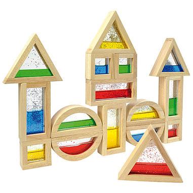 Bocs en bois avec paillettes pour jeux de construction. Activités de motricité fine.