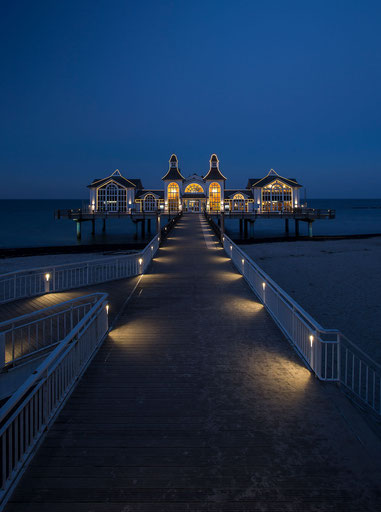 Illuminated historical seebruecke pier in Sellin on the island of Ruegen, Baltic Sea, North East Germany, Europe