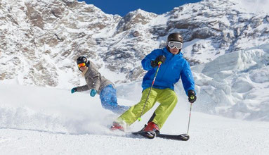 Skiing and snowboarding in the snow guaranteed area of the Saas Valley