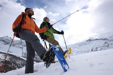 Snowshoe walking in a stunning mountain scenery