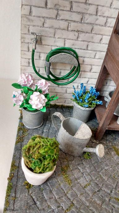 Miniatur Wasserschlauch und Wasserhahn