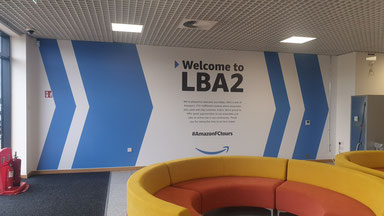 A photo of the LBA2 Amazon reception wall