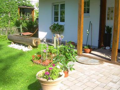 Hauseingang mit hauseigener Quelle für Gäste