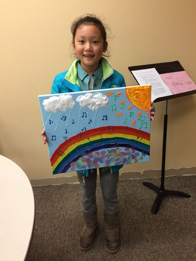 A student with her art project for the Kitsap Music Teachers Association Ribbon Festival.