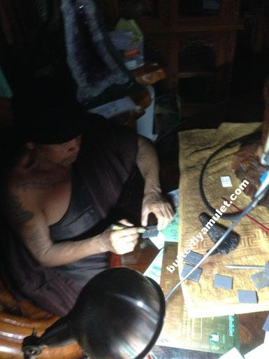Kruba Krissana signing amulets