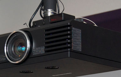 That little box on top of the projector is the Industrologic IR232.