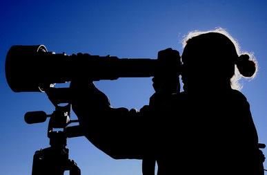 Fotograph mit Teleskopobjektiv