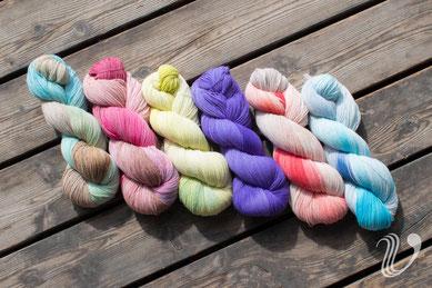 Farben von links nach rechts: Lagune, Choccobeere, Caipirinha, Ultra Violett, Flamingo, Meeresbrandung