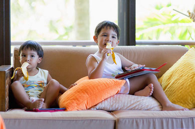 Picture of my 2 sons eating a banana at the same time, watch their look which give also a story to the photograph.