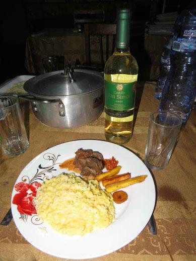 Risotto mit Ziegenfleisch, Kochbananen und Pili-Pili