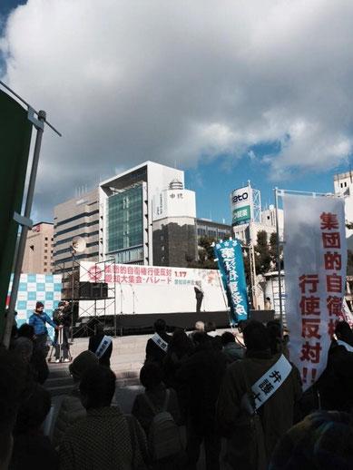 愛知県弁護士会大集会であいさつする冨島照男弁護士