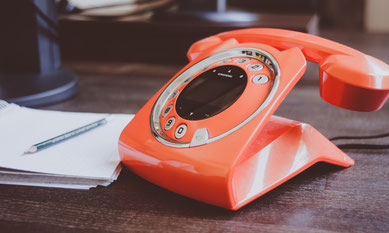 Tangerine coloured dial phone