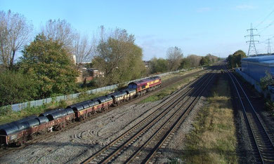 Castle Bromwich Station platform 2008 visible on the left beyond the train. Viewed from the site of the station building on the Chester Road bridge. The British Industries Fair buildings stood to left of the railway line.