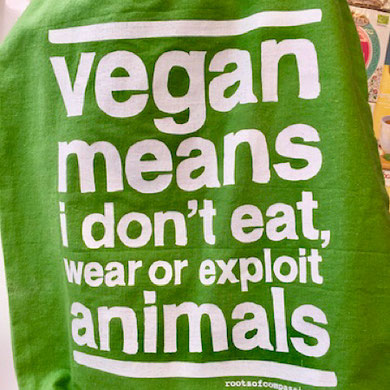 "vegan bag from roots of compassion ""vegan means i don't eat, wear or exploit animals"""