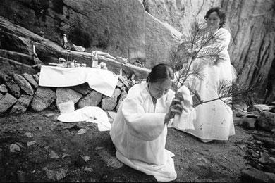 Hi-ah Park salutes the spirits at Mt. Samgak, as her godmother recites invocations