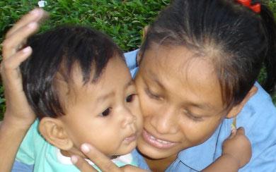 PRENDRE UN ENFANT DANS SES BRAS