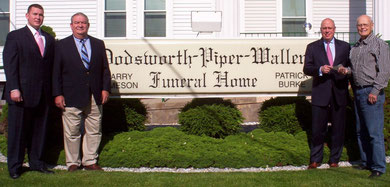 Louis Battin, far right, president of the McDonough County Historical Society, received a matching grant donation for the MCHS cemetery sign project from Jim Burke and Larry and Eric Jameson of the Dodsworth-Piper-Wallen Funeral Home in Macomb.