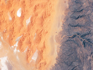 "The Tifernine Dune Field is located at the southernmost tip of the Grand Erg Oriental, a ""dune sea"" that occupies a large portion of the Sahara Desert in eastern Algeria. The image was acquired by ISS, NASA. ©NASA-JSC."