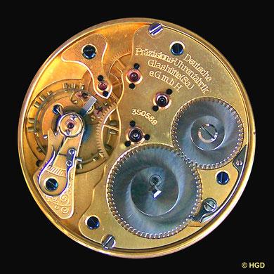 Werkseite - 5 verschraubte Goldchatons; Gangpartie mit Müller-Anker
