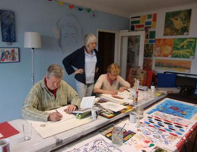 Dieter und Elfi intensiv arbeitend