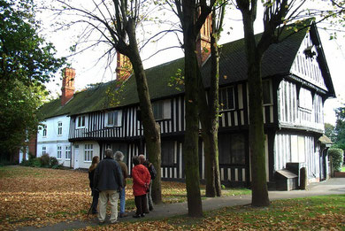 The Old Grammar School. The onlookers are members of the Kings Norton Local History Society on a visit led by City Archaeologist, Mike Hodder.