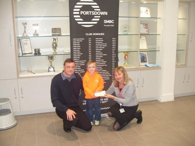 Sam receiving the cheque for a magnificient £1225