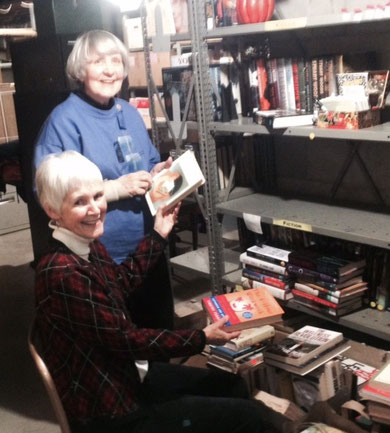 Friends Susan Boynton and Sally Schumann sorting donated books