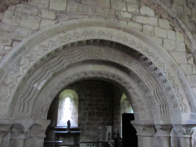 The patterned late-12th-century arch is set inside an earlier mid-12th-century arch visible in the top right and left of the photograph.