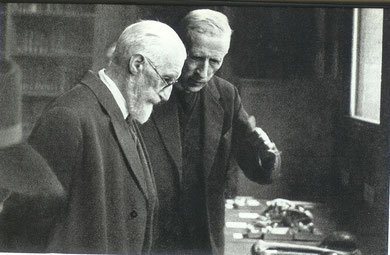 Pere Teilhard de Chardin and Lucien Cuenot examining fossils from the Far East, in the Institute of Human Palaeontology.