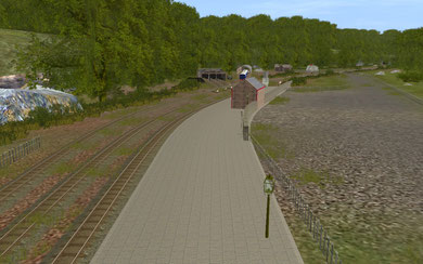 """Arlesdale North Station (A.K.A. """"The Old Station"""") with main engine sheds and carriage shelter in the background"""