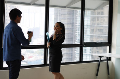 Life coaching session between a man and woman in an office