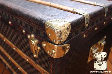 the Louis Vuitton trunk in brass corners
