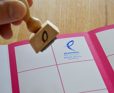 Stempel und Pilgerausweis