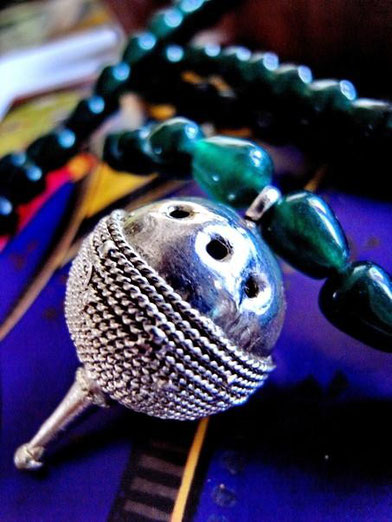 Pagadi: dark-green, teardrop, jade necklace; side-view of sterling-silver ball