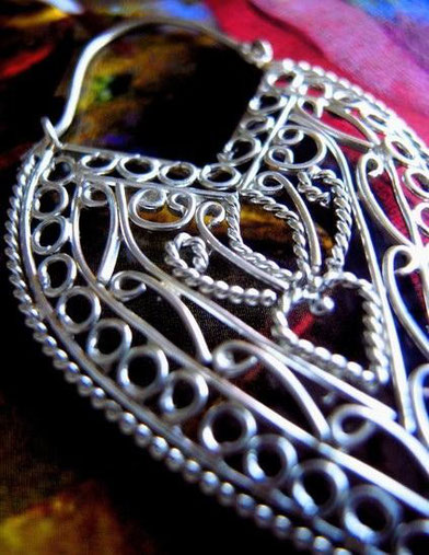 Mehndi: ornate, sterling-silver earrings; close-up of wire-work