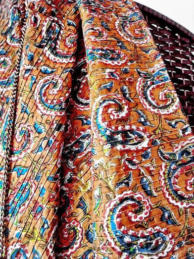Mustard brown, pinched pleat, Indian cotton throw; close-up of green, paisley & vine print