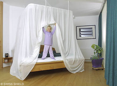 Canopy made from Swiss Shield microwave reflecting shielding fabric protecting children from elevated levels of electromagnetic radiation.